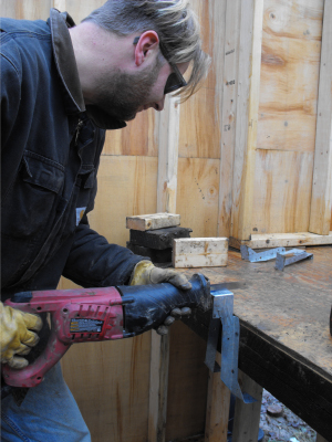 Cutting a bracket in half with the saw-saw