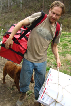 oversized bag image of man carrying said container