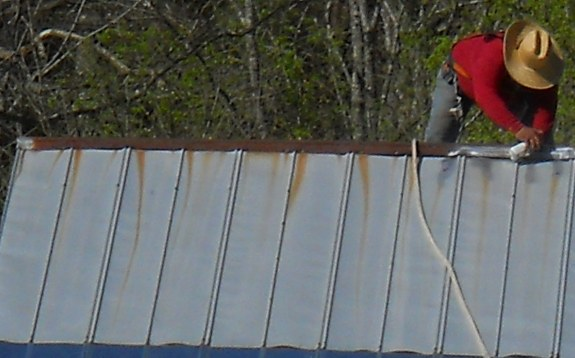 fixing rust spots on a metal barn roof
