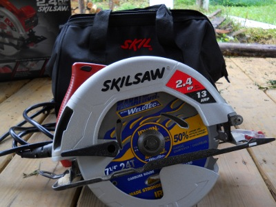 new 13 amp Skil circular saw with carry bag/purse