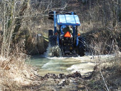 Tractor fording a creek