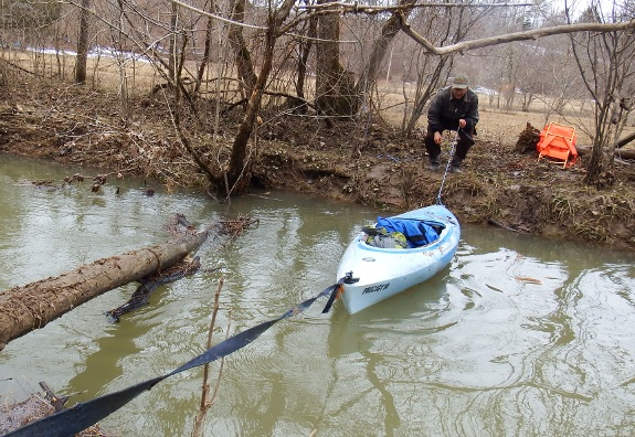 using kayak to get groceries across creek