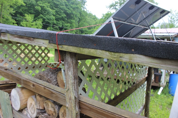 Harbor Freight solar panels mounted on top of wood shed.