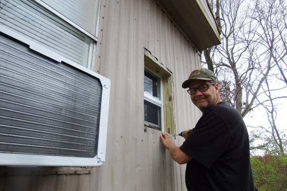 Installing new window in a trailer.